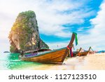 longtail boat parked on natural ... | Shutterstock . vector #1127123510