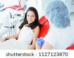 young beautiful girl in dental... | Shutterstock . vector #1127123870