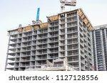 apartment building construction ... | Shutterstock . vector #1127128556