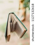 books hung to decorate an... | Shutterstock . vector #1127132618