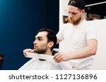 hairdresser puts paper collar...   Shutterstock . vector #1127136896