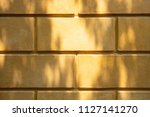 yellow brick wall in the roman... | Shutterstock . vector #1127141270
