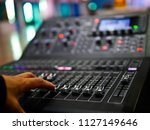 soft focus hand adjusting... | Shutterstock . vector #1127149646