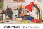 lamp on schoolboy desk | Shutterstock . vector #1127170613