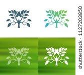 abstract tree concept logo.   Shutterstock .eps vector #1127203850