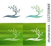 abstract tree concept logo.   Shutterstock .eps vector #1127203868