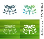 abstract tree concept logo.   Shutterstock .eps vector #1127203874