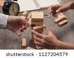hand of engineer point a blocks ...   Shutterstock . vector #1127204579