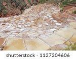 terraces and salt ponds in... | Shutterstock . vector #1127204606