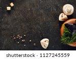 white champignon mushrooms on...   Shutterstock . vector #1127245559
