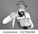 cook with hungry face in... | Shutterstock . vector #1127284388
