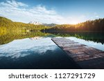 peaceful view of black lake....   Shutterstock . vector #1127291729