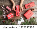 woman wrapping christmas gift... | Shutterstock . vector #1127297933