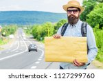 man bearded hitchhiker stand at ... | Shutterstock . vector #1127299760