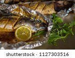 baked mackerel with salt  lemon ... | Shutterstock . vector #1127303516
