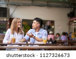 mixed race young couple talking ... | Shutterstock . vector #1127326673