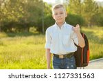 stylish and young schoolboy in... | Shutterstock . vector #1127331563