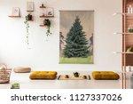 yellow poufs on the floor in... | Shutterstock . vector #1127337026