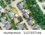 Vertical aerial view of a suburban settlement in Germany with detached houses, close neighbourhood and gardens in front of the houses, drone shot