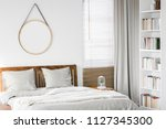 fresh plant placed on bedside... | Shutterstock . vector #1127345300
