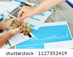 mother and child counting money ...   Shutterstock . vector #1127352419