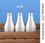 milk bottles fresh with flip... | Shutterstock .eps vector #1127359304