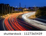 Traffic light trails of fast moving vehicles travelling along the M5 motorway near Bristol, England