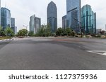 empty road with modern business ... | Shutterstock . vector #1127375936