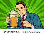 man with a mug of beer foam.... | Shutterstock .eps vector #1127378129