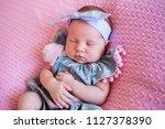 beautiful newborn girl wearing... | Shutterstock . vector #1127378390
