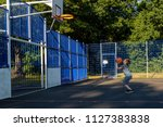 Pre-teen boy shooting basket ball in a park - stock photo