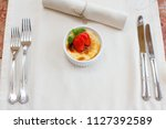 cream brulee in a strawberry... | Shutterstock . vector #1127392589
