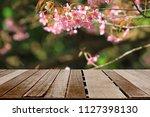 old wood floor with pink sakura ... | Shutterstock . vector #1127398130