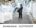 man work fogging to eliminate...   Shutterstock . vector #1127419259