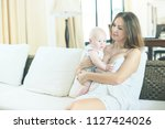 portrait happy family young... | Shutterstock . vector #1127424026