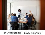 female high school tutor at... | Shutterstock . vector #1127431493