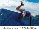 low angle view of man getting... | Shutterstock . vector #1127443856