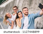 bearded handsome man is... | Shutterstock . vector #1127448899