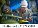 engineering man wearing white... | Shutterstock . vector #1127453840