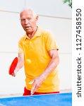 Portrait Of Elderly Man With...
