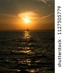 warm summer night  sunset in... | Shutterstock . vector #1127505779