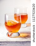 two glasses filled with whiskey ... | Shutterstock . vector #1127523620