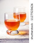 two glasses filled with whiskey ... | Shutterstock . vector #1127523626