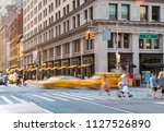 people and taxis in the... | Shutterstock . vector #1127526890