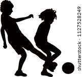 two boys playing football ... | Shutterstock .eps vector #1127528249