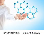 molecules in the hand ... | Shutterstock . vector #1127553629