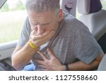 man suffering from motion... | Shutterstock . vector #1127558660