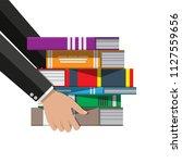 pile of books in hand. reading... | Shutterstock .eps vector #1127559656