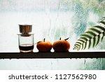 two orange fruit  coffee cup ... | Shutterstock . vector #1127562980