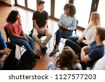female tutor leading discussion ... | Shutterstock . vector #1127577203
